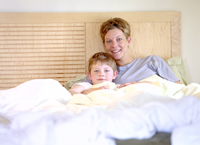 Mother and Son Relaxing In Bed