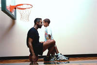 Father and Son at Basketball Gym